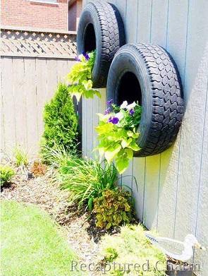Gard de gradina decorat cu roti de masina