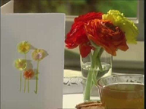 Model felicitare de 8 martie cu un buchet de flori din servetele